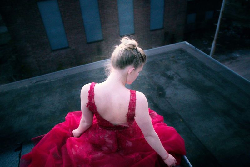 Beauty in Red Lost Places Red Portrait One Person Real People Pink Color High Angle View Day Standing Outdoors Blond Hair Young Adult First Eyeem Photo