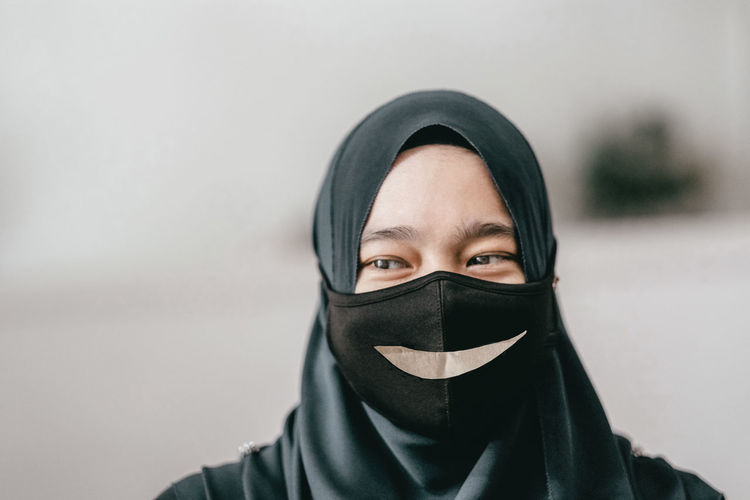 Close-up of young woman covering face