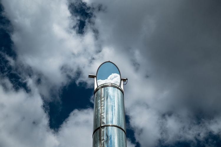 Low angle view of tower against cloudy sky
