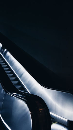 Low angle view of escalator in dark building