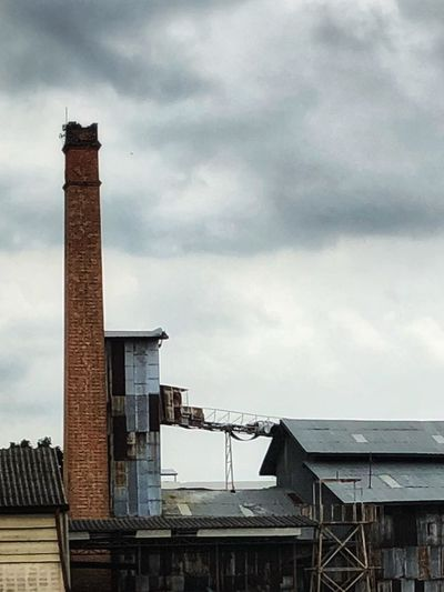 OLD RICE MILL Architecture Built Structure Cloud - Sky Sky Building Exterior Nature No People Architectural Column Smoke Stack Water Low Angle View City Tall - High Outdoors Industry Travel Destinations Building Factory Day Tower