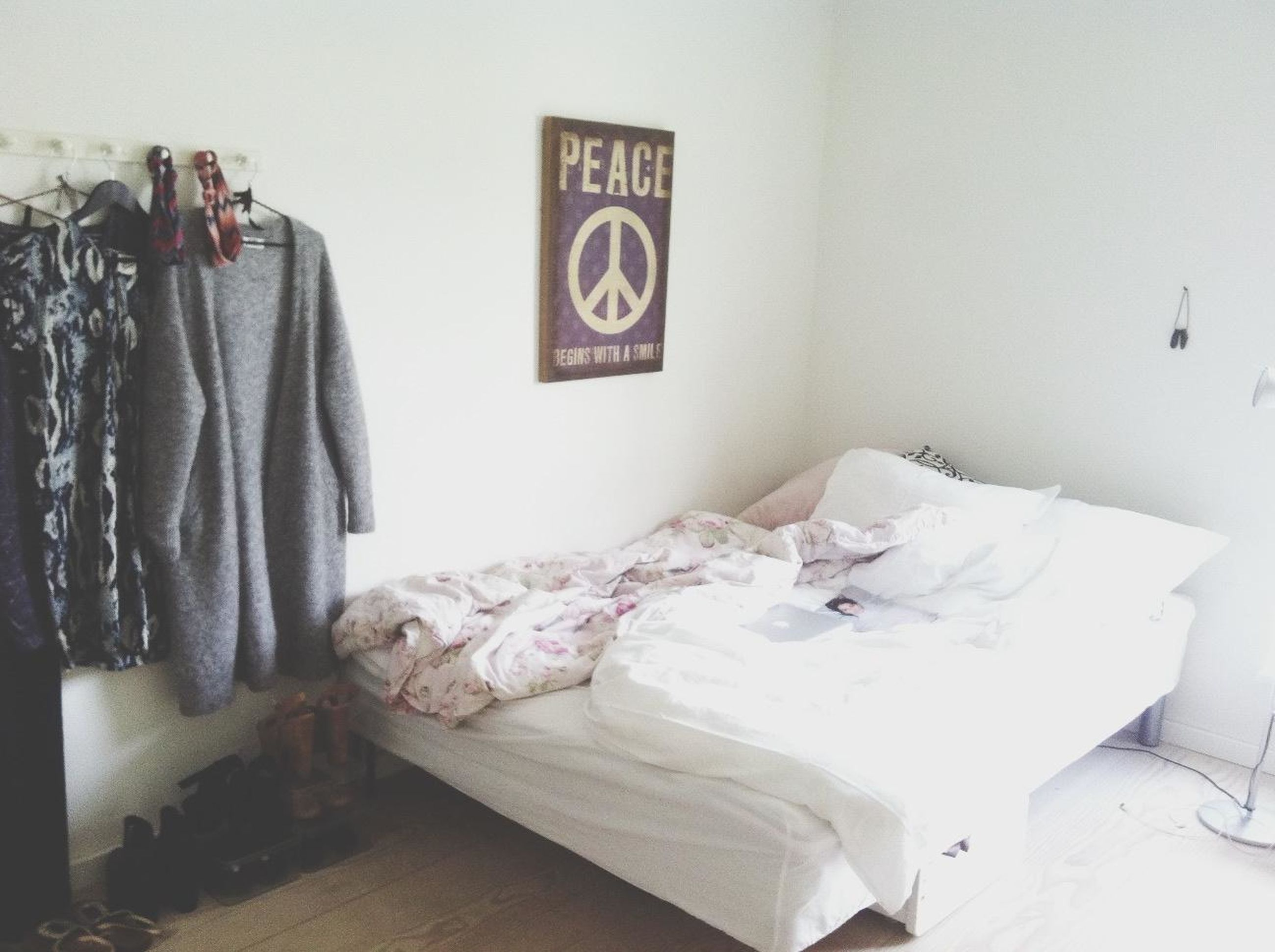 indoors, text, western script, communication, bed, paper, pillow, home interior, bedroom, white color, clothing, wall - building feature, sheet, non-western script, white, fabric, no people, book, still life, store