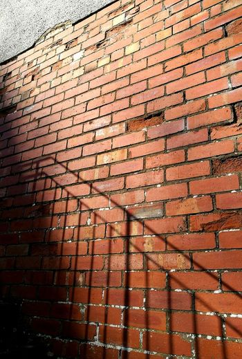 Built Structure Brick Wall Architecture Full Frame Low Angle View Outdoors Backgrounds Lines Sunlight Streetphotography Striking Light And Shadow Textures Close-up Metal iron Railings Sunlight Shadows Brickwork  Building Exterior Shapes And Forms Cloud - Sky Sky Abstract Forfar town