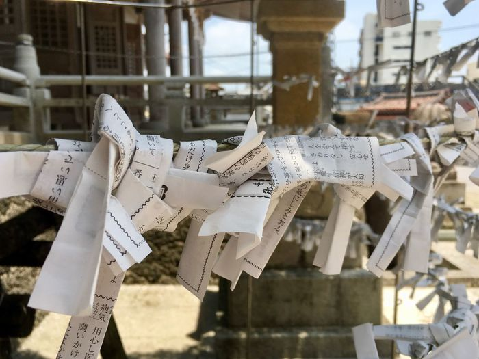 Fortunes prayers tied on pole at shrine