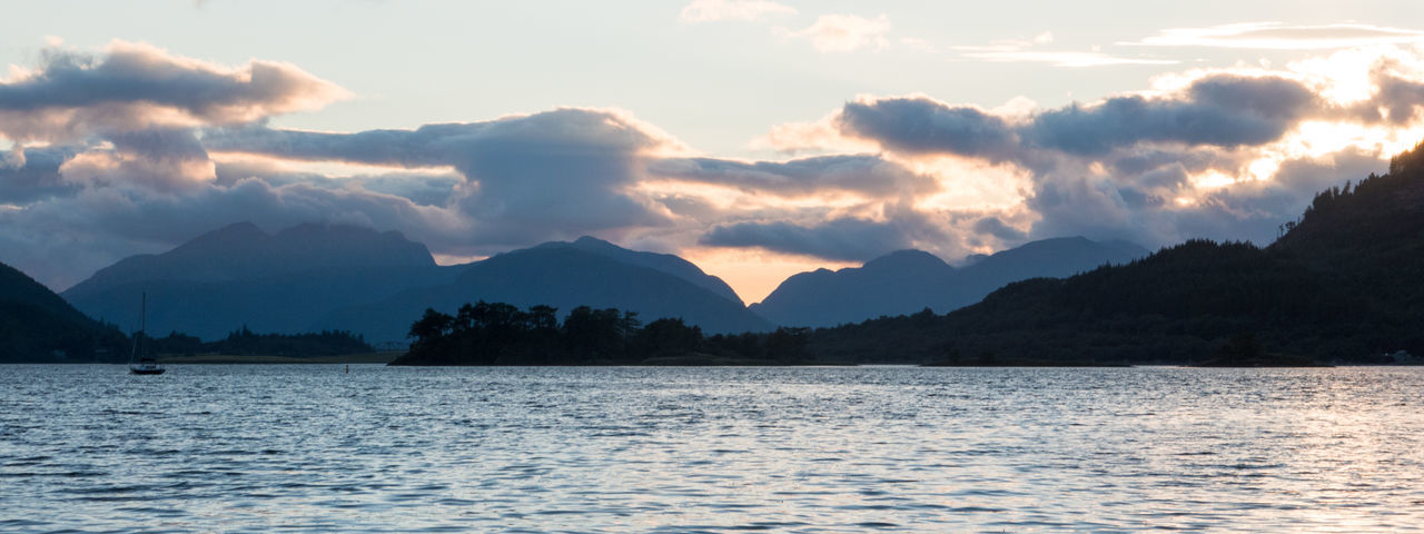 Sunset Over Loch Leven in Glencoe, Scotland Glencoe Loch  Loch Leven Scotland Beauty In Nature Boat Cloud - Sky Highlands Lake Mountain Mountain Range Nature No People Outdoors Scenics Scottish Highlands Sky Sunset Tranquil Scene Tranquility Tree Water Waterfront