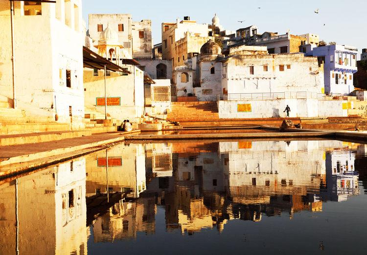 Houses Reflecting In Pushkar Lake During Sunset
