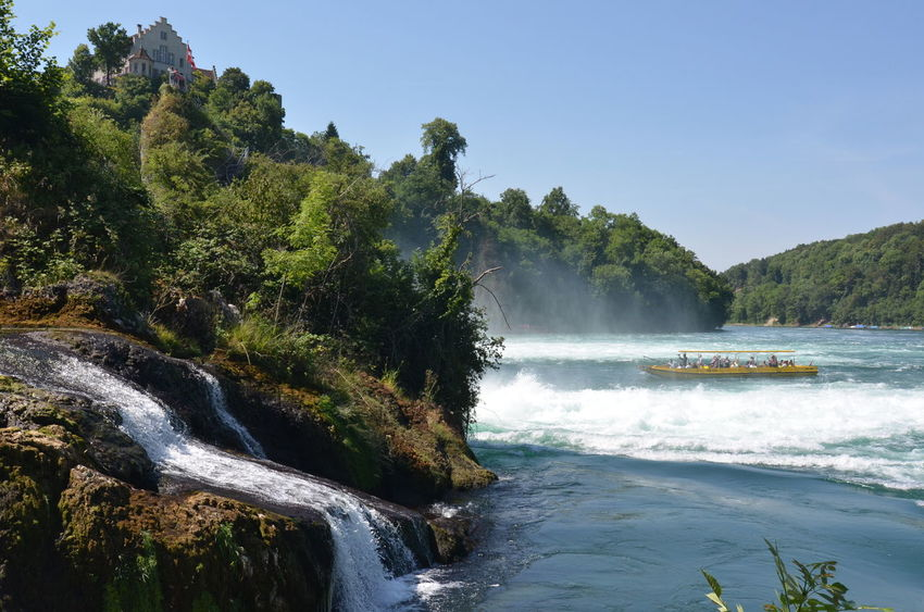 Adventure Beauty In Nature Boat Ride Capture The Moment Curiosity Distant Exploring Idyllic Mountain Range Nature Outdoors Power In Nature Rheinfall Rhine Falls Switzerland Tranquil Scene Traveling Of Ship Vacation Water Water_collection Waterfall Waterfront