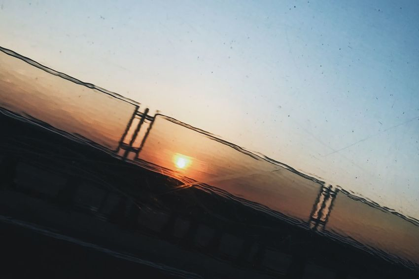 Sunset_collection Architecture Beauty In Nature Bright Building Building Exterior Built Structure Cable Connection IPhoneography Low Angle View Nature No People On The Road Orange Color Outdoors Rail Transportation Scenics - Nature Silhouette Sky Sun Sunlight Sunset Water