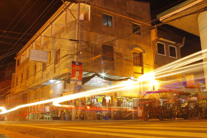Architecture Building Exterior Built Structure City Street Economy Illuminated Light Trail Lightphotography Long Exposure Modern Motion Nighlights Night No People Outdoors Philippines ❤️ Ruralscapes Sky Street Street Light Travel Destinations