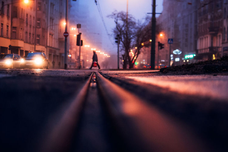 Surface Level Of Railroad Track On Road In City At Night