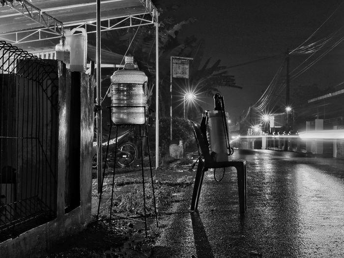 Man sitting on street at night
