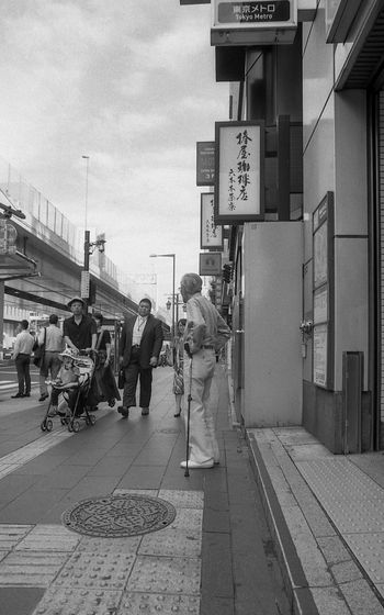 Street Photography Streetphotography Tokyo Black And White Blackandwhite Film Photography Film Group Of People Transportation City Architecture Sign Real People Men Text Street Sky Built Structure Communication Building Exterior Rail Transportation People Railroad Track Adult Walking Day Track