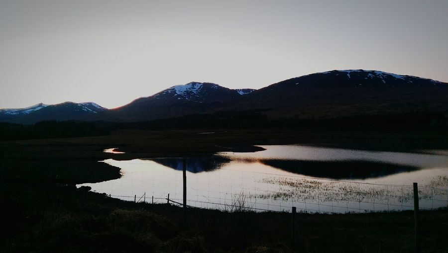 Sunset Silhouettes Water Reflections Mountains And Sky Scottish Highlands Summertime Nice Views Breathtaking View Taking Photos Mobile Photography Evening Sky