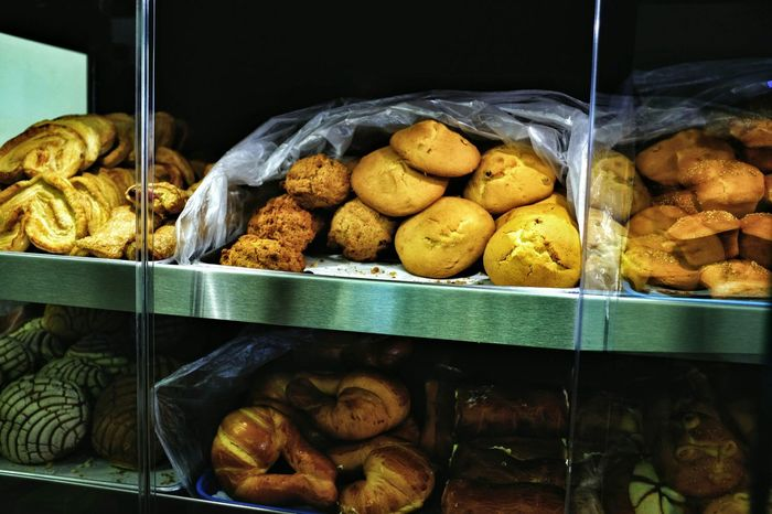 "Pan dulce (lit. ""sweet bread"") is one of the poster treats in Mexico and other Latin American countries. One of the first non-native foods that was introduced to Mexico by Spain was wheat, a Spanish religious necessity. The creation of sweet bread was influenced by the French and Spaniards who were the ones that introduced baked goods such as crispy rolls, baguettes, and sweet pastries to Mexico. This inspired the indigenous peoples to create different types of pan dulces such as besos, conchas, and cuernos amongst others. The bread is considered to be one of Mexico's most inexpensive treats and is consumed daily as breakfast or late supper, known as merienda. Besos (Kisses) are a Mexican sweet bread that is very popular on Valentine's Day. It is made by creating round domes on the top with a drop filling of jam in the middle. Shopping Bakery Pan Dulce Valentine's Day  Mexican Food Kisses Breakfast The Places I've Been Today Rural America Mexicana"
