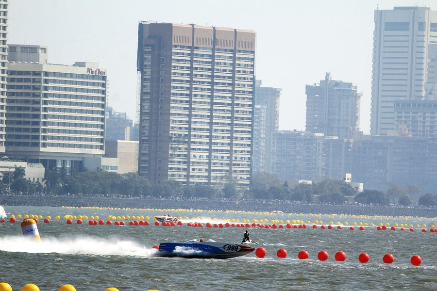 Nautical Vessel City Water Outdoors Day People Adult Sports Race Business Finance And Industry Skyscraper Reflection Sea Race Boat Race  Water Sports Power Boats Boats Urban Skyline Architecture Boat Cityscape Building Exterior Modern
