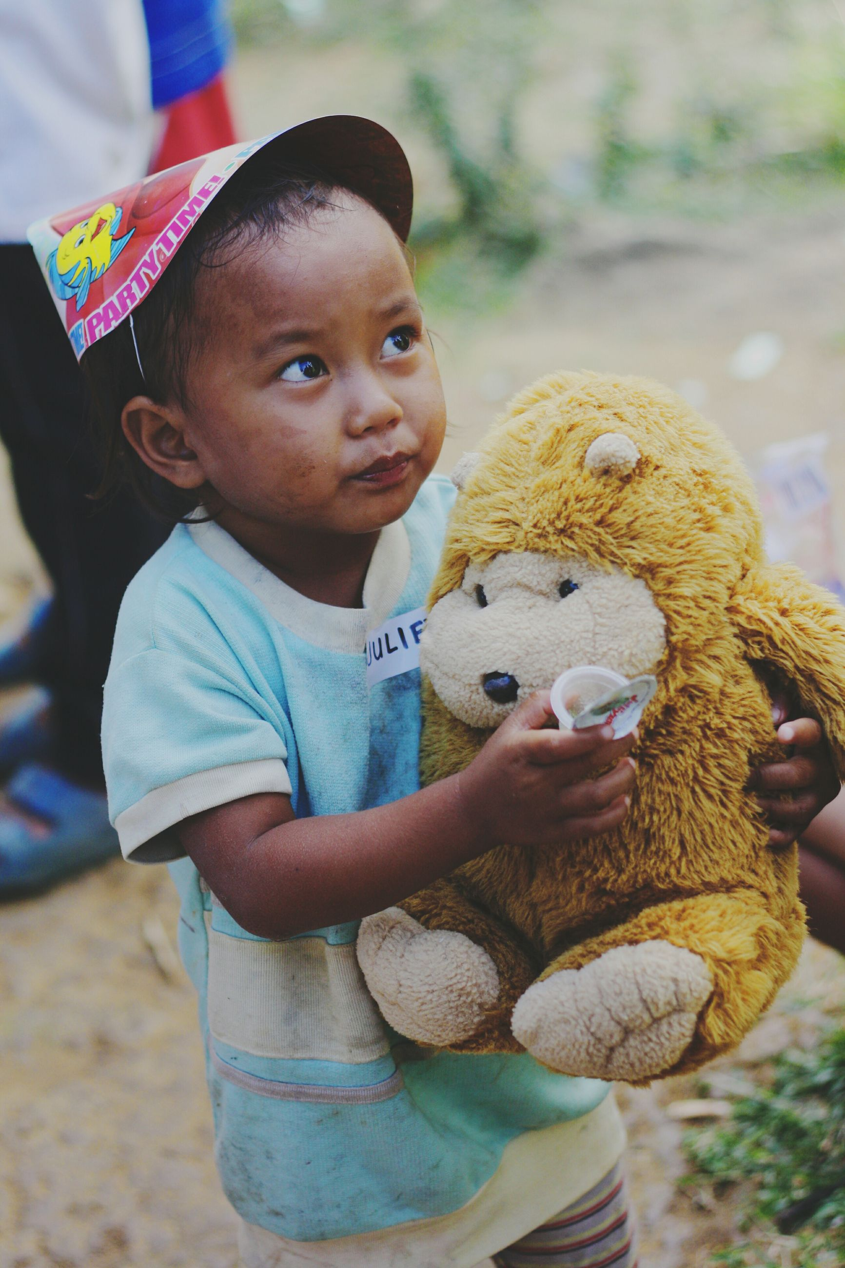 childhood, teddy bear, stuffed toy, looking at camera, real people, toy, portrait, innocence, one person, cute, focus on foreground, boys, holding, happiness, lifestyles, day, smiling, outdoors, close-up, people