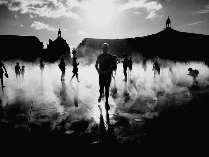People walking on floor during foggy weather