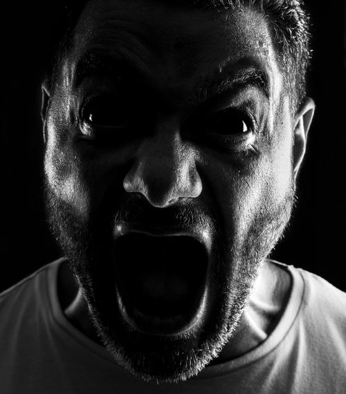 Scream Angry Adult Aggression  Anger Black Background Close-up Emotion Front View Headshot Horor Human Face Indoors  Looking At Camera Males  Men Mid Adult Mid Adult Men Mouth Mouth Open One Person Portrait Real People Scream Shouting Studio Shot