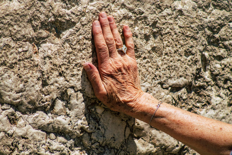 Close-up of hand in mud