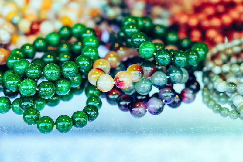 Close-up of multi colored bead on table