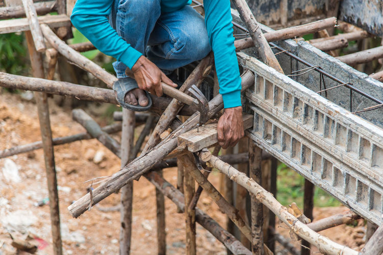 Construction Construction Site Hard Work Industry Man Rock Teamwork Worker Working Build Build Structure Building Building Exterior Built Structure Cement Construction Industry Construction Work Construction Worker Material Mixing Outdoor Pile Stone Structure