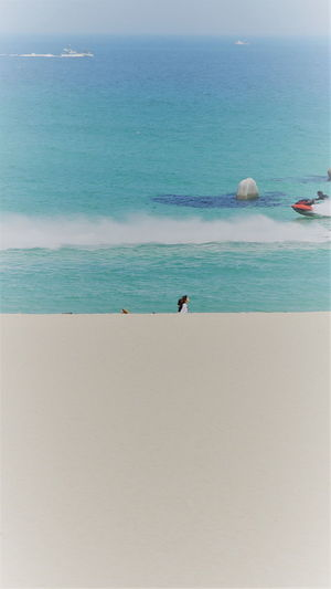 Beach Sea Sand Water Nature Horizon Over Water Vacations Day Wave Blue Outdoors Jet Ski Ship Rock