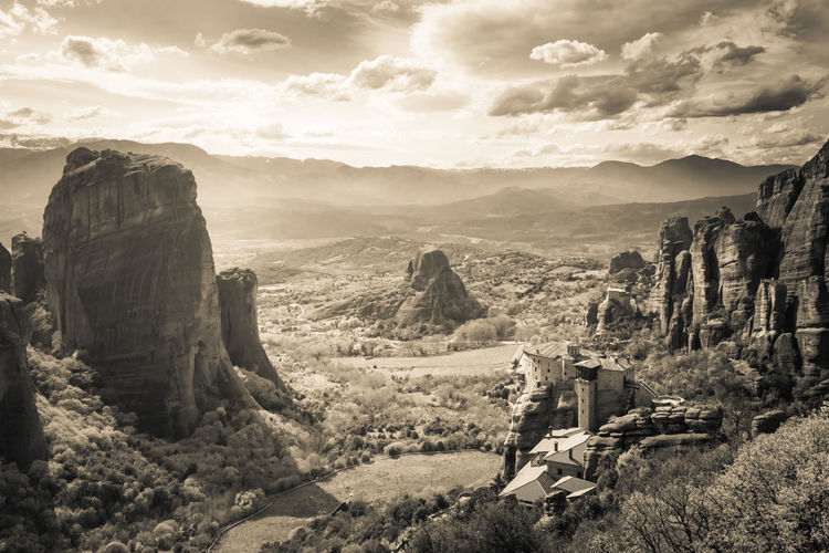 Meteora landscape, a unique rock formation in central Greece. Abbey Mountain Sky Rock Landscape Range Outdoors Formation Nature Toned Monochrome Panorama Inaccessible Prehistoric Valley Kalampáka Kalambaka Religion Monastery Temple Gigantic Cliff Clouds Rock Christian Church Travel Destination Edge Attraction Cloudscape Cloudy Fog Crag Landmark Picturesque Unique Thessaly Spiritual Black And White Sepia Orthodox Majestic Hill Greek Countryside Country Land Cloister Scenery