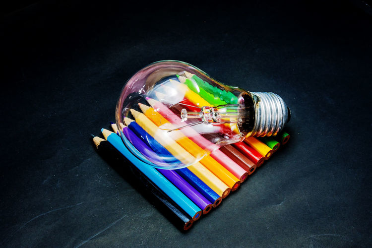 High angle view of multi colored pencils in jar