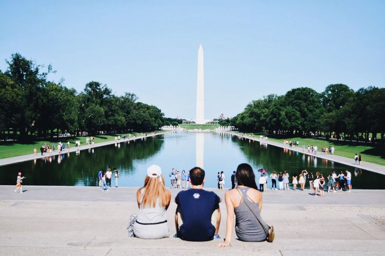 People against reflecting pool and washington monument