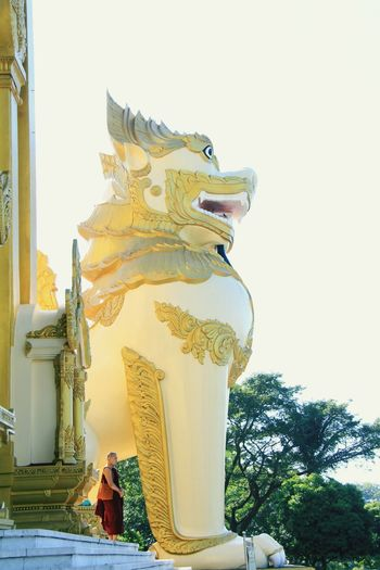 Religion Belief Sculpture Place Of Worship Statue Architecture Building Spirituality Animal Outdoors Art And Craft Nature Built Structure Animal Themes Ancient History No People Day Shwedagon Pagoda Yangon, Myanmar