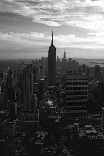 High Angle View Of Empire State Building In City Against Sky
