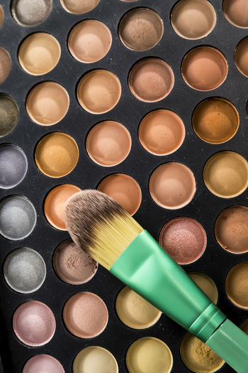 Close-Up Of Eyeshadow And Brush