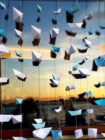Digital composite image of paper flags hanging