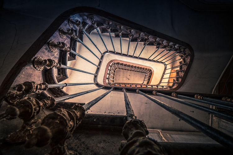 Directly Below Shot Of Spiral Staircase Of Abandoned Building