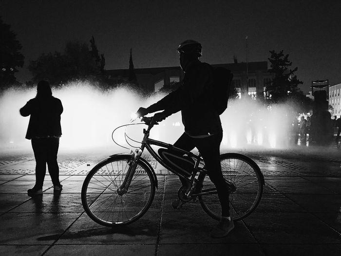 Dark Rider IPhone Reflection City Tourist Sportsman Night Blackandwhite Bicycle Real People Water Motion Men Cycling Mode Of Transport Riding Splashing Wet Outdoors Silhouette Lifestyles