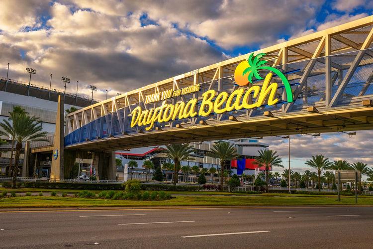Graffiti on bridge against cloudy sky