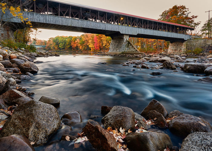 Covered bridge in Main Autumn River Autumn colors Covered Bridge Maine Fall River Road Foliage Plant Maine In Fall Old Bridge Bridge - Man Made Structure Covered Bridge Foliage In Maine Outdoors River River Maine Smooth Water
