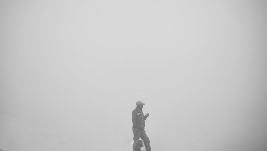 Side view of a woman standing on foggy day