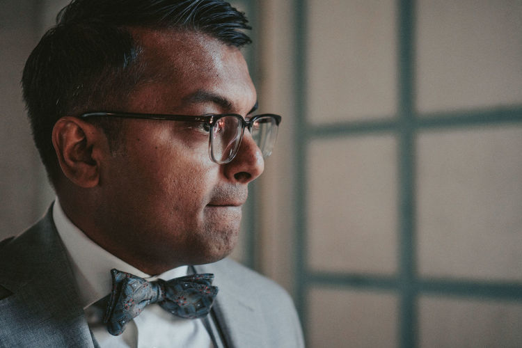 Headshot One Person Bow Tie Portrait Real People Focus On Foreground Glasses Indoors  Close-up Lifestyles Looking Away Eyeglasses  Looking Men Leisure Activity Adult Wedding Wedding Photography