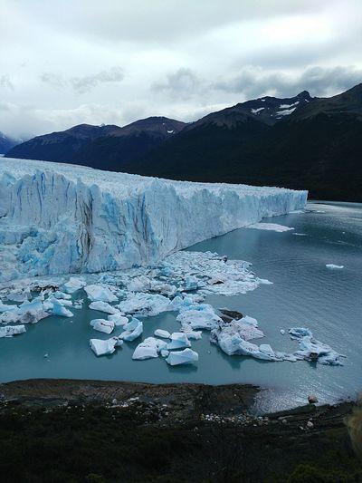 Idyllic Shot Of Perito Moreno Glacier Against Cloudy Sky