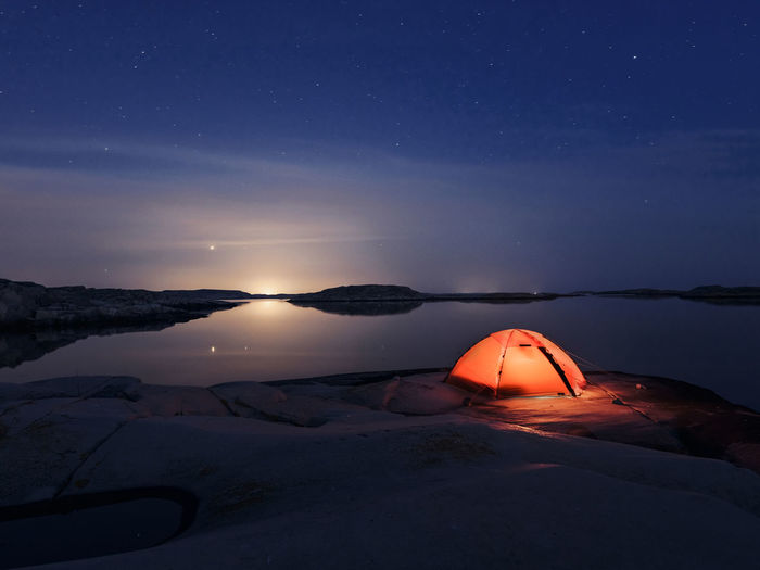 Scenic view of rock against sky at night