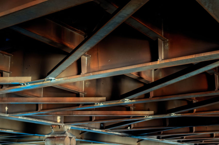 under a bridge Metal Beams Rust Abundance Architecture Backgrounds Building Built Structure Close-up Construction Industry Day Factory Full Frame Large Group Of Objects Metal No People Pattern Selective Focus Stack