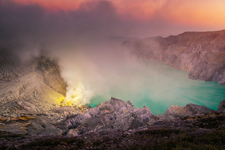 Landscape of Kawah Ijen volcano in sunrise scene of Indonesia. Mountain Smoke - Physical Structure Beauty In Nature Scenics - Nature Volcano Non-urban Scene Environment Geology Nature Heat - Temperature No People Tranquil Scene Physical Geography Landscape Emitting Sky Tranquility Power In Nature Land Erupting Volcanic Crater Outdoors Kawah Ijen INDONESIA Travel