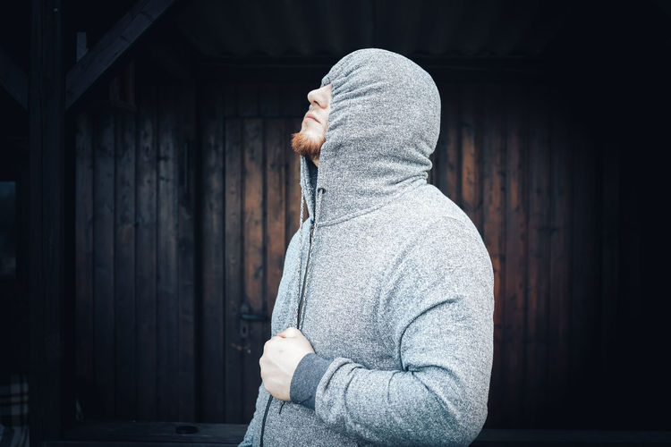 Woman In Hood Clothing Standing Outdoors