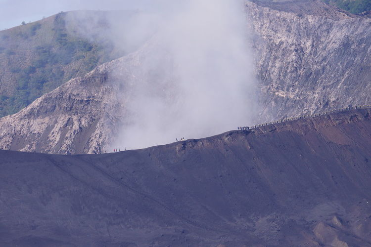 Mt Bromo Beauty In Nature Day Dramatic Landscape Fog Foggy Geology High Up Idyllic Land Feature Majestic Mist Mountain Mountain Peak Mountain Range Nature Non-urban Scene Outdoors Physical Geography Remote Scenics Tourism Tranquil Scene Tranquility Travel Destinations Valley Lost In The Landscape