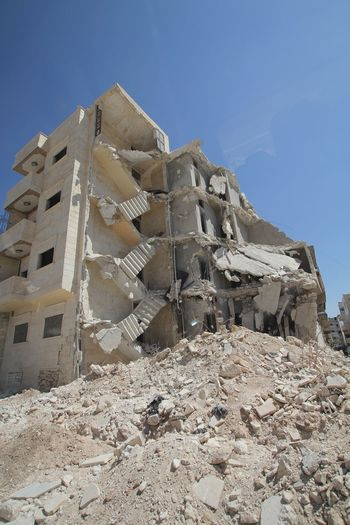 Collapsed building in Aleppo, Syria PEACE NO WAR Syria  Collapsed Building Crisis Demolitionbyneglect Destroyed Buildings Effect Of War Fallen Fallen Buildings Humanitarian Humanitarianaid No Mercy War