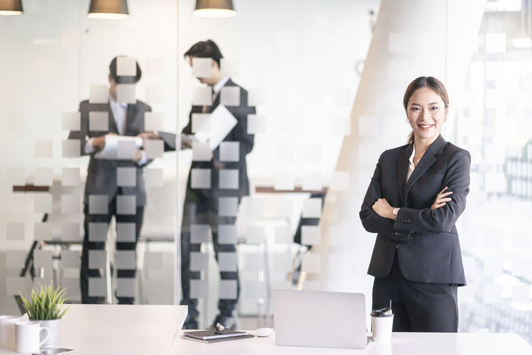 Portrait of businesswoman with arms crossed at office