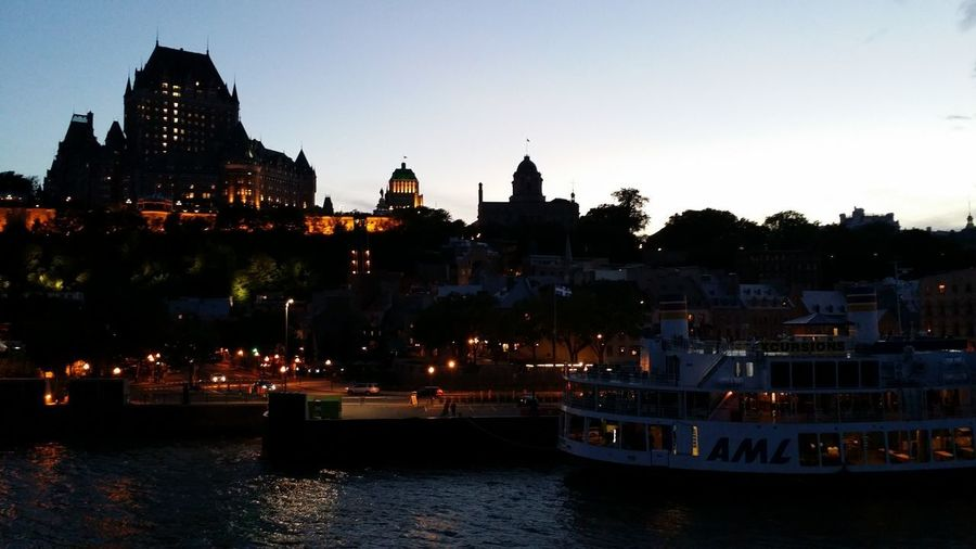 View of illuminated buildings at waterfront