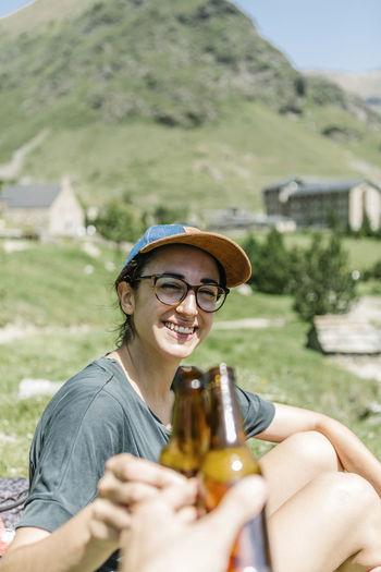 Portrait of smiling man holding beer bottle