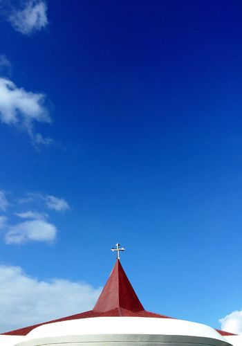 High section of chapel against blue sky